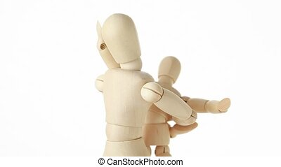 rotating wooden figures of child embracing his parent by shoulders, on white