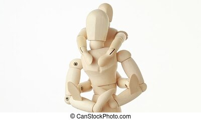 rotating wooden figures of child sitting on neck of his parent, half body