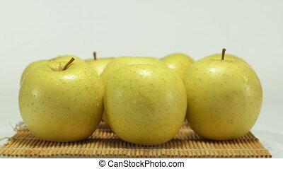 Rotating yellow apples