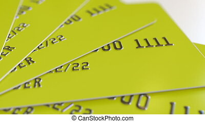 Rotating yellow credit cards, loopable motion background