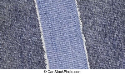 Rotation a light strip of denim with a place for your text,...