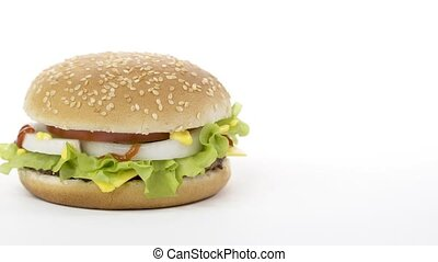 Rotation. Appetizing burger on a white background.