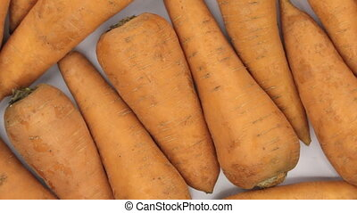 Rotation close-up, background of carrots. Food background