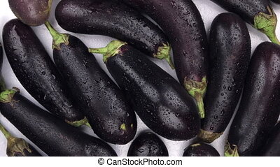 Rotation close-up, the background of violet eggplant. Food...