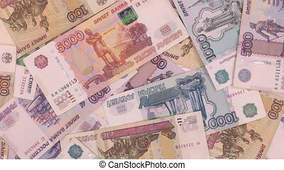Rotation of a business background, made from ruble bills. View from above