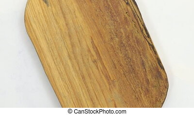 Rotation of a rectangular frame made of pine wood. View from...
