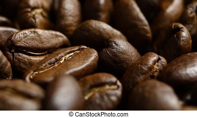 Rotation of aromatic roasted coffee beans. Close up....