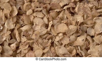 Rotation of buckwheat flakes close-up. Instant buckwheat. ...