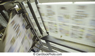 rotation of conveyor belt of printed products in plant.
