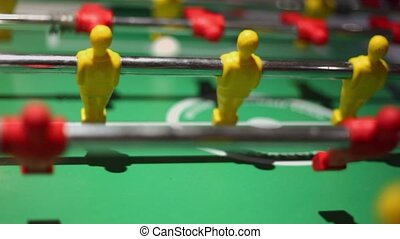 Rotation of plastic toy players from table soccer game -...