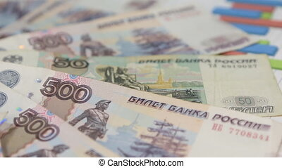 Rotation of rubles laid out in the form of a circle, lying...