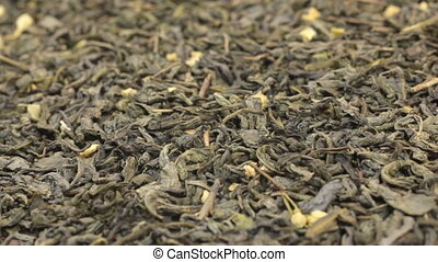 Rotation of the background of whole dry leafs of green tea....