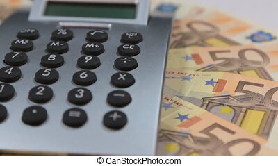 Rotation of the calculator and euros, lying on the diagrams.