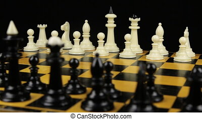 Rotation of the chessboard with the figures arranged for the...
