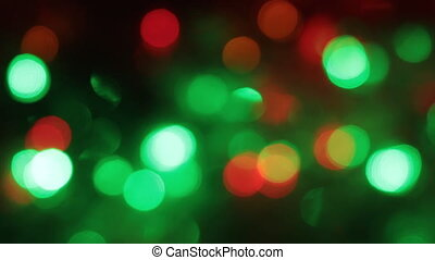 Rotation of the colorful and blinking Christmas bokeh. Abstract background with bokeh