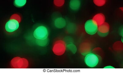 Rotation of the colorful and blinking Christmas bokeh. Abstract background with bokeh,