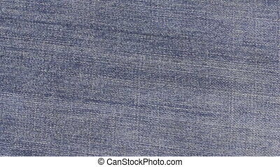 Rotation of the denim texture, shot close-up. View from...