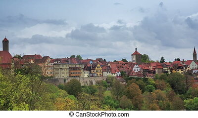 Rothenburg on Tauber cityscape above the forest, cloudy...