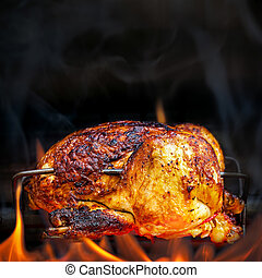 Rotisserie Chicken Cooking Over Open Flames - Charred...