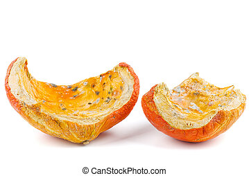 Rotten pumpkin pieces isolated on white background