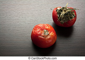 Rotten tomato single red rotten tomato isolated against white rotten tomato ccuart Choice Image