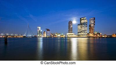 Rising moon over the Rotterdam Skyline
