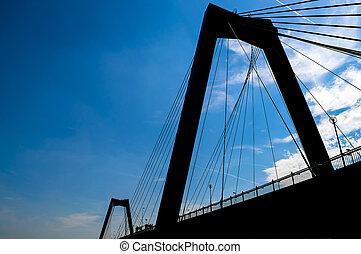 Rotterdam bridge silhouette in blue sky