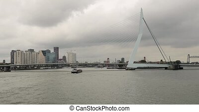 Rotterdam city view from a boat, view of buildings and the Erasmus Bridge from the water