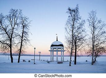 Rotunda on winter lake on sunset ti