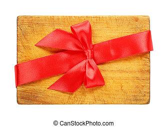 rouges, planche découper, ruban, arc