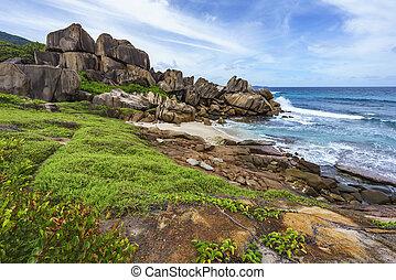 Rough and wild rocky coastline at anse songe, la digue, seychelles 10