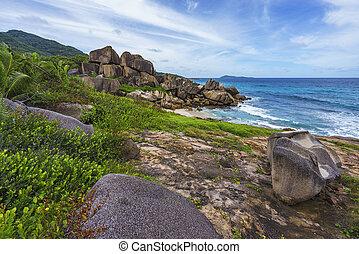 Rough and wild rocky coastline at anse songe, la digue, seychelles 13