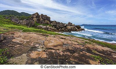 Rough and wild rocky coastline at anse songe, la digue, seychelles 14