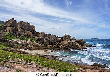 Rough and wild rocky coastline at anse songe, la digue, seychelles 16