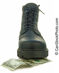 Rough boot treads on a money banknote