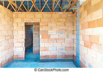 rough construction of a brick family house