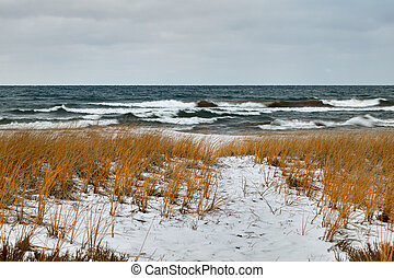 Rough lake and snow covered winter shoreline - Rough, stormy...
