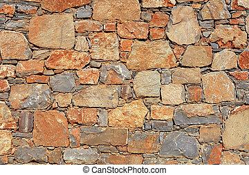 rough mediterranean stone wall as background.