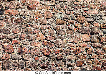 Rough natural old stone wall as background