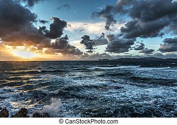 rough sea at sunset in Sardinia