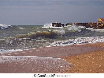 rough sea sand beach with beautiful sandstone cliffs