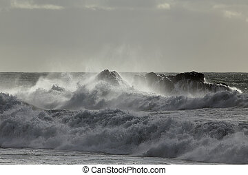 Rough sea spray Northern portuguese rocky coast.