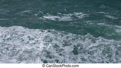 Rough turquoise sea - Waterscape with rough wavy turquoise...
