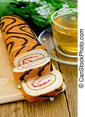 Roulade with a cup of tea on board