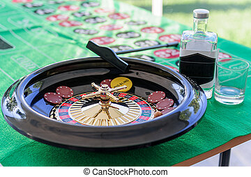 roulette game on the table with a green blanket