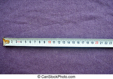 Roulette is 23 centimeters on a background of purple cloth.