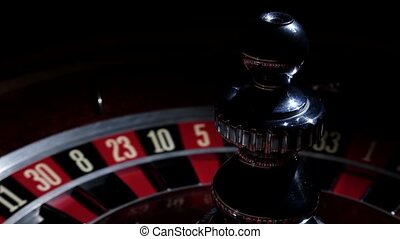 Roulette wheel running and stops with white ball on 2