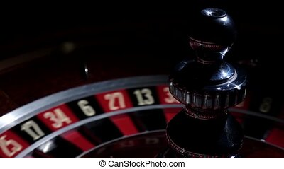 Roulette wheel running and stops with white ball on 20