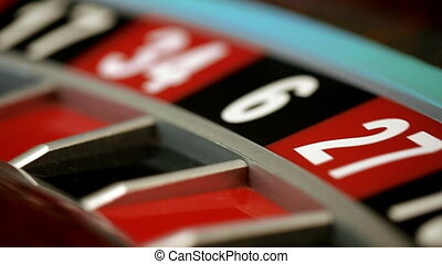 Roulette wheel running and stops with white ball on 22 close-up