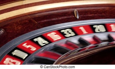 Roulette wheel running with white ball